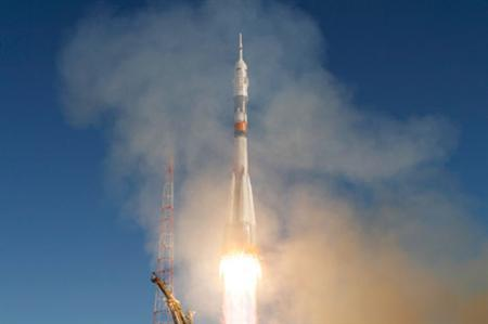 U.S.-Russian crew dock at space station