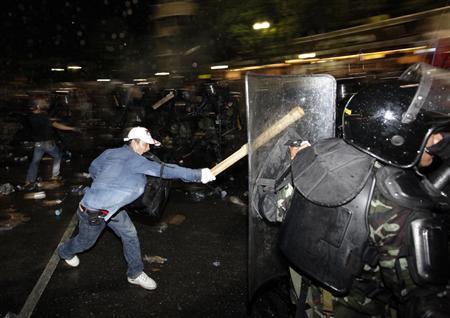 Twelve die as troops, protesters clash in Bangkok