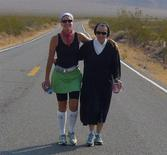 <p>Lisa Smith Batchen and Sister Mary Beth Lloyd at Batchen's 310-mile run through Death Valley in a 2008 photo. REUTERS/Handout</p>