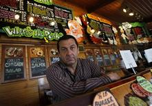 """<p>Robert Egan, the owner of Cubby's BBQ in Hackensack, New Jersey, poses for a photograph at Cubby's in this picture taken April 16, 2010. Egan is the Author of """"Eating with the Enemy"""" a memoir of his unlikely friendship with North Korean diplomats. REUTERS/Shannon Stapleton</p>"""