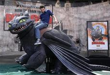 """<p>Cast member Jay Baruchel rides a mechanical dragon at the premiere of the film """"How to Train Your Dragon"""" in Los Angeles March 21, 2010. REUTERS/Phil McCarten</p>"""