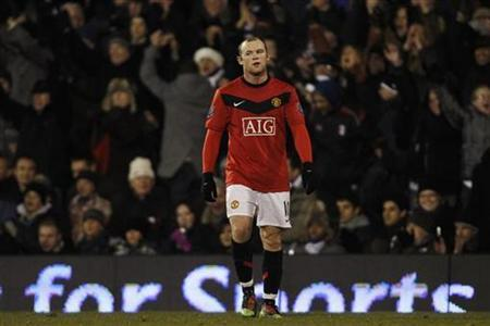 Manchester United's Wayne Rooney reacts after losing their English Premier League soccer match against Fulham at Craven Cottage in London December 19, 2009. REUTERS/Stefan Wermuth NO ONLINE/INTERNET USAGE WITHOUT A LICENCE FROM THE FOOTBALL DATA CO LTD. FOR LICENCE ENQUIRIES PLEASE TELEPHONE ++44 (0) 207 864 9000