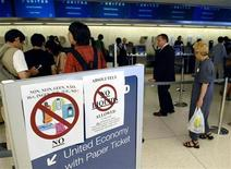 <p>Passengers at the United Airlines check-in counter are greeted by notices warning them not to bring any liquids on board their flights at JFK International Airport in New York August 10, 2006. U.S. President George W. Bush will make a statement on Thursday about a plot to blow up airplanes flying to the United States that British authorities said they foiled, White House spokesman Tony Snow said. REUTERS/Chip East (UNITED STATES)</p>