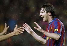 <p>Lionel Messi comemora seu segundo gol na goleada do Barcelona sobre o Tenerife por 4 x 1. REUTERS/Albert Gea</p>
