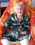<p>Eugenie Blanchard sits in the Hospital Bruyn, in Gustavia on the Caribbean Island of Saint-Barthelemys February 19, 2010. Blanchard, a former nun, was born on February 16, 1896 and is 114 years old. She is now the oldest person in the world, according to French media, after Kama Chinen of Japan passed away on May 2, 2010. REUTERS/Pere Pinya</p>