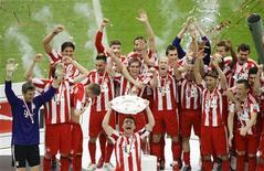 <p>O Bayern Munich comemora o título alemão. O Bayern de Munique bateu o rebaixado Hertha Berlin por 3x1 neste sábado para conquistar o Campeonato Alemão pela 22 vez e mantêm as esperanças de conquistar a Tríplice Coroa.08/05/2010.REUTERS/Morris Mac Matzen</p>