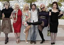 """<p>Director Mathieu Amalric (3rd R) and cast members (L to R) Evie Lovelle, Julie Atlas Muz, Mimi Le Meaux, Kitten On The Keys and Dirty Martini attend a photocall for the film """"Tournee"""" at the 63rd Cannes Film Festival May 13, 2010. Nineteen films compete for the prestigious Palme d'Or which will be awarded on May 23. REUTERS/Vincent Kessler</p>"""
