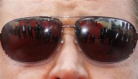 "<p>Photographers are reflected in cast member Russell Crowe's glasses as he arrives for the screening of ""Robin Hood"" by director Ridley Scott and for the opening ceremony of the 63rd Cannes Film Festival May 12, 2010. REUTERS/Yves Herman</p>"