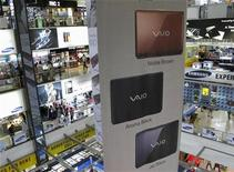 <p>A giant banner promotes Sony's Vaio laptops at Sim Lim Square, in Singapore March 3, 2009. REUTERS/David Loh</p>