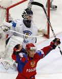 <p>Finland's goaltender Petri Vehanen sits on ice as Russia's Maxim Afinogenov celebrates a goal scored by team mate Nikolai Kulemin during their Hockey World Championships match in Cologne May 18, 2010. REUTERS/Grigory Dukor</p>