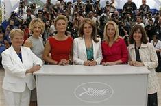 """<p>(R to L) Producer Diane Weyermann, Former CIA operative Valerie Plame Wilson, Queen Noor Al Hussein of Jordan, Director Lucy Walker, actress Meg Ryan, and former Norwegian Prime Minister Gro Harlem Bruntland pose during a photocall for the film """"Countdown to zero"""" at the 63rd Cannes Film Festival, May 16, 2010. REUTERS/Jean-Paul Pelissier</p>"""