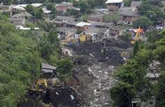 <p>11 aprile 2010, frana a Rio de Janeiro. REUTERS/Bruno Domingos</p>
