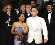 """<p>Director Apichatpong Weerasethakul (2nd R) and cast member Wallapa Mongkolprasert arrive for the screening of """"Lung Boonmee Raluek Chat"""" (Uncle Boonmee Who Can Recall his Past Lives) in competition at the 63rd Cannes Film Festival May 21, 2010. REUTERS/Yves Herman</p>"""