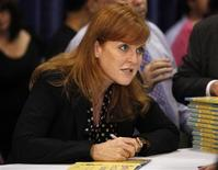 """<p>Sarah Ferguson, Britain's Duchess of York, signs copies of her book """"Helping Hand Books: Emily's First Day at School"""" at the BookExpo America in New York May 26, 2010. REUTERS/Shannon Stapleton</p>"""
