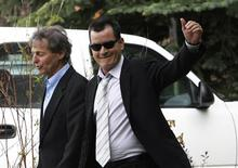 <p>Actor Charlie Sheen (R) waves as he leaves the Pitkin County Courthouse with his attorney Richard Cummins after a court hearing in Aspen, Colorado June 7, 2010. Sheen's court hearing for a Christmas Day assault on his wife was postponed on Monday until July. No agreement was reached at the hearing as to the disposition of the case against him as a plea deal did not go through as planned. REUTERS/Rick Wilking</p>