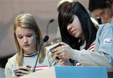 <p>Kate Moore (L) and Morgan Dynda of the U.S. compete in the LG Mobile Worldcup Texting Championship in New York in this January 14, 2010 file photo. REUTERS/Mike Segar/Files</p>