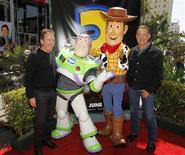 "<p>Actor Tim Allen (L), who plays the voice of the character Buzz Lightyear (2nd L), and Tom Hanks (R), who plays the voice of character Woody, pose together at the world premiere of Disney Pixar's ""Toy Story 3"" at the El Capitan Theatre in Hollywood, California June 13, 2010. REUTERS/Danny Moloshok</p>"