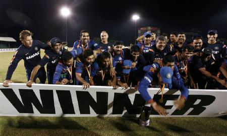 India cricket team members celebrate their victory over Sri Lanka in final match of the Asia Cup one-day international cricket tournament in Dambulla June 24, 2010. REUTERS/Andrew Caballero-Reynolds