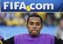 <p>Brazil's Robinho sits on the bench before the start of the 2010 World Cup Group G soccer match between Brazil and Portugal at Moses Mabhida stadium in Durban June 25, 2010. REUTERS/Kai Pfaffenbach</p>