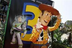"""<p>Character Woody poses next to a poster depicting fellow character Buzz Lightyear at the world premiere of Disney Pixar's """"Toy Story 3"""" at the El Capitan Theatre in Hollywood, California June 13, 2010. REUTERS/Danny Moloshok</p>"""