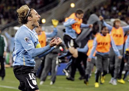 Penalty miss denies Ghana as Uruguay advance - Reuters
