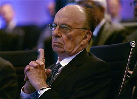 News Corporation Chairman and CEO Rupert Murdoch listens to morning discussion session during the Wall Street Journal CEO Council on ''Rebuilding Global Prosperity'' in Washington, November 17, 2009. REUTERS/Hyungwon Kang