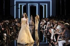<p>Models present creations by Lebanese designer Elie Saab as part of his Fall/Winter 2010-2011 Haute Couture fashion show in Paris July 7, 2010. REUTERS/Gonzalo Fuentes</p>