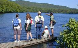 <p>Hikers on a pier at Kent Pond in Killington, Vermont July 2008. REUTERS/New Life Hiking Spa/Handout</p>