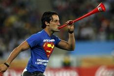<p>A man blows a vuvuzela on the field and interrupts game play in the 2010 World Cup semi-final soccer match between Germany and Spain at Moses Mabhida stadium in Durban July 7, 2010. REUTERS/Ina Fassbender</p>