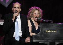 "<p>James Taylor (L) and Carole King perform ""You've Got a Friend"" at the 2006 ""Musicares Person of the Year"" gala in Los Angeles February 6, 2006. REUTERS/Mario Anzuoni</p>"