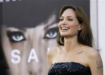 """<p>Cast member Angelina Jolie smiles at the premiere of the movie """"Salt"""" at the Grauman's Chinese theatre in Hollywood, California July 19, 2010. REUTERS/Mario Anzuoni/Files</p>"""