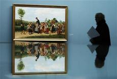 "<p>A visitor and the painting ""Der Schulspaziergang"" by late Swiss painter Albert Anker (1831-1910) are reflected in a mirror, during a media preview of the exhibition ""Beautiful World"" on the occasion of the centenary of the painter's death, in Bern May 4, 2010. REUTERS/Michael Buholzer</p>"