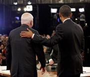 <p>Republican presidential nominee Sen. John McCain (R-AZ) (L) gets a pat on the back from Democratic presidential nominee Sen. Barack Obama (D-IL) after their presidential debate at Hofstra University in Hempstead, New York, October 15, 2008. REUTERS/Charles Dharapak/Pool</p>