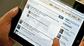 <p>A Facebook page is shown on an iPad in this undated publicity image released to Reuters in Los Angeles August 17, 2010. REUTERS/Inigral Inc./Handout</p>