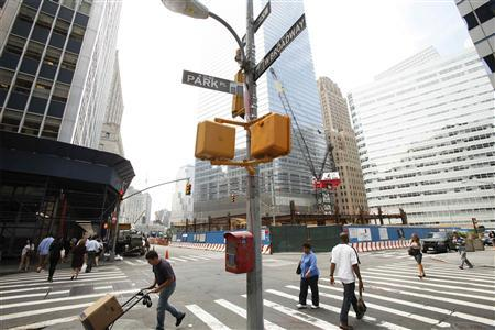 Pedestrians walk past the street corner where a lower Manhattan building that will possibly house the Cordoba Initiative Mosque and Cultural Center is located in New York August 17, 2010. REUTERS/Lucas Jackson