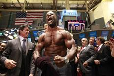 """<p>Actor Terry Crews (C) poses shirtless for photographers on the floor of the New York Stock Exchange, August 19, 2010. Crews and castmates Sylvester Stallone (L), Dolph Lundgren (obscured) and Jason Statham (not in picture) from the film """"The Expendables"""" rang the opening bell at the New York Stock Exchange. REUTERS/Brendan McDermid</p>"""