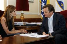 <p>U.S. actress Angelina Jolie (L) speaks with Haris Silajdzic, a Muslim member of the Tripartite Bosnian Presidency, during her visit to Sarajevo August 21, 2010. Office/Handout</p>