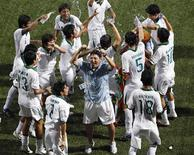 <p>Bolivia's players and coach Douglas Cuence (C) celebrate after winning against Haiti at the men's soccer gold medal match at the Singapore 2010 Youth Olympic Games (YOG) in Singapore August 25, 2010. REUTERS/Issei Kato</p>