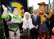 """<p>Former NASA astronaut Buzz Aldrin (2nd R) and his wife Lois Aldrin pose with characters Buzz Lightyear (L) and Woody (R) at the world premiere of Disney Pixar's """"Toy Story 3"""" at the El Capitan Theatre in Hollywood, California June 13, 2010. REUTERS/Danny Moloshok</p>"""