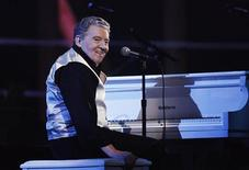 <p>Jerry Lee Lewis smiles after performing during the first of two 25th Anniversary Rock & Roll Hall of Fame concerts in New York October 29, 2009. REUTERS/Lucas Jackson</p>