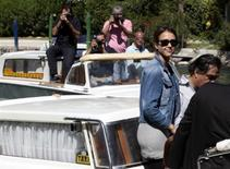 """<p>Actress Jessica Alba (2nd R) arrives at the Excelsior Palace in Venice August 31, 2010. Alba will attend the screening of her movie """"Machete"""" directed by Robert Rodriguez at the opening of 67th Venice Film Festival on September 1. REUTERS/Alessandro Bianchi</p>"""