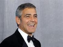 <p>Actor George Clooney poses backstage after receiving the Bob Hope Humanitarian Award at the 62nd annual Primetime Emmy Awards in Los Angeles, California, August 29, 2010. REUTERS/Danny Moloshok</p>