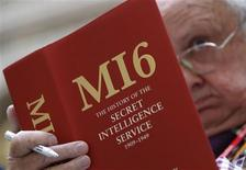 <p>A man leafs through a copy of The History of the Secret Intelligence Service at its launch at the Foreign Office in central London, September 21, 2010. The book's author, historian Keith Jeffery, was given access to Britain's MI6 archives up to 1949, the first time the inteligence service's files have ever been made available for research. REUTERS/Andrew Winning</p>