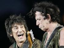 """<p>The Rolling Stones' Ron Wood (L) and Keith Richards perform during the band's """"A Bigger Bang"""" European Tour in Bucharest, Romania July 17, 2007. REUTERS/Bogdan Cristel</p>"""