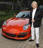<p>Uwe Gemballa, founder of Gemballa Automobiletechnik, poses with the Porsche Gemballa Avalanche GTR-650 EVO (997 Turbo) during its South East Asia launch in Singapore, July 31, 2008. REUTERS/Tim Chong</p>