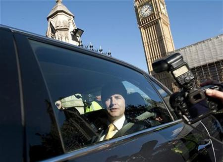 Deputy Prime Minister Nick Clegg leaves the House of Commons by car in London October 20, 2010. REUTERS/Kieran Doherty