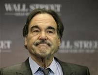 """<p>U.S. Director Oliver Stone poses during a photocall promoting his film """"Wall Street: Money Never Sleeps"""" in Berlin, October 12, 2010. REUTERS/Thomas Peter</p>"""