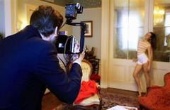 """<p>Jonathan Leder photographs a model during a casting photo shoot for the adult magazine """"Jacques"""" in New York October 22, 2010. While other publishers adapt to the digital age, """"Jacques"""" stands out among rival adult magazines by using old-fashioned film and natural light to shoot pictorials of naked women with a retro-inspired aesthetic. The """"Jacques"""" mantra: spend a little on quality, and your book will sell for more -- to more people. Picture taken October 22, 2010. REUTERS/Lucas Jackson</p>"""