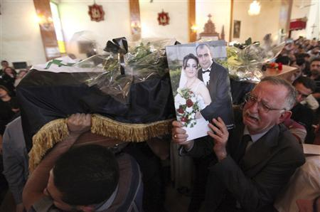 Iraq probes church raid; says attackers disguised