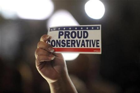 A supporter holds up a bumper sticker at the California Republican Party election night party in Irvine, California November 2, 2010. REUTERS/Phil McCarten
